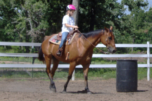 Child riding at camp